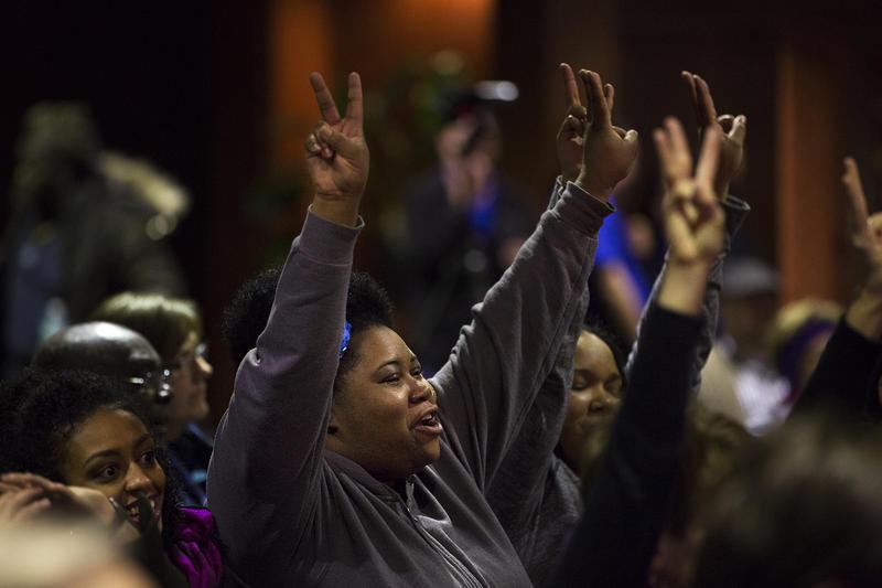 Ferguson resident Tiffani Reliford shows her support for Laverne Mitchom.