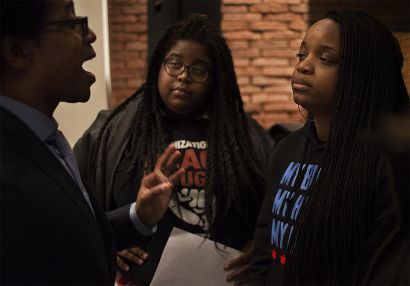 Council member Wesley Bell answers questions from organizers and activists Kayla Reed, of Organization for Black Struggle, and Brittany Packnett, of Campaign Zero.