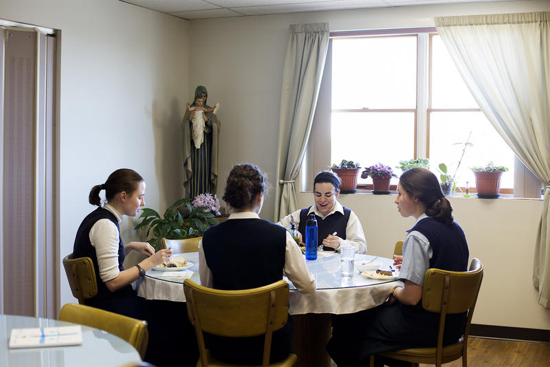 Postulants of the Daughters of St. Paul have lunch in the dining room of convent in Crestwood.