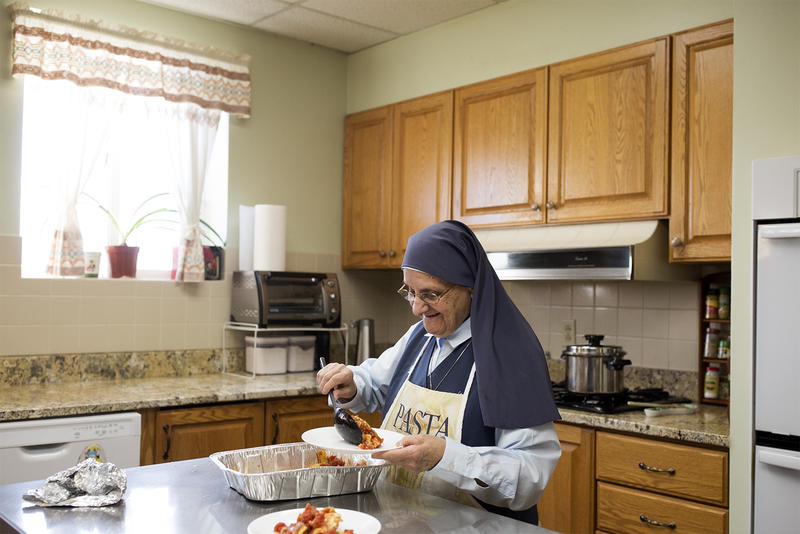 Sister Mary Joan Baldino serves breakfast in the convent of the Daughters of St. Paul in Crestwood.