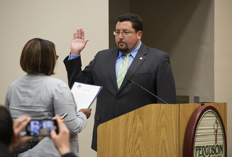 Ferguson Mayor James Knowles takes the oath of office at Ferguson City Hall Tuesday night.