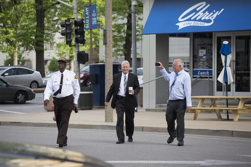 St. Louis Circuit Court Judge Rex Burlison speaks with a reporter as St. Louis Sheriff Vernon Betts escorts him into the courthouse on May 10, 2018.