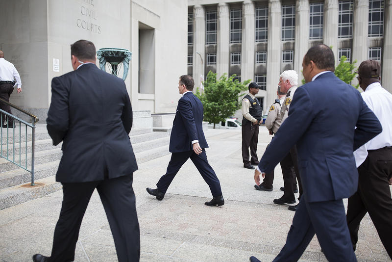 Gov. Eric Greitens walks back into the Civil Courts Building in downtown St. Louis after delivering a statement to reporters. May 14, 2018