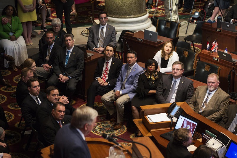 Members of the state Senate and statewide elected officials listen as Gov. Mike Parson addresses a joint session of the Missouri General Assembly.
