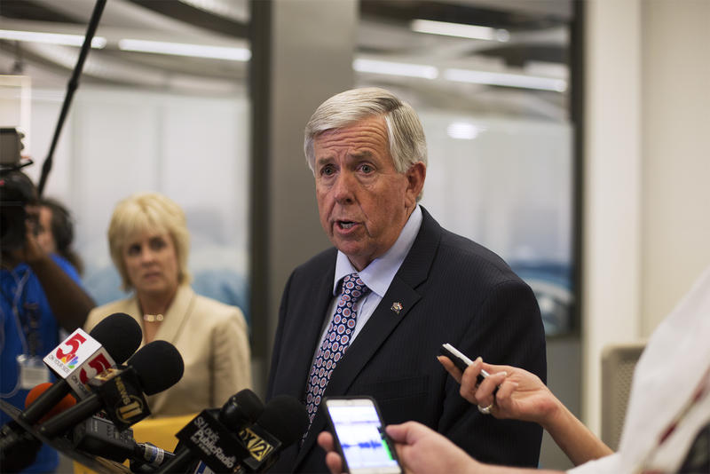 Gov. Mike Parson answers questions from news reporters at Cortex Innovation Community in St. Louis on June 13, 2018.