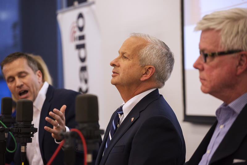 John Brunner tilts his head back as Eric Greitens speaks at St. Louis Public Radio's GOP gubernatorial candidate debate.