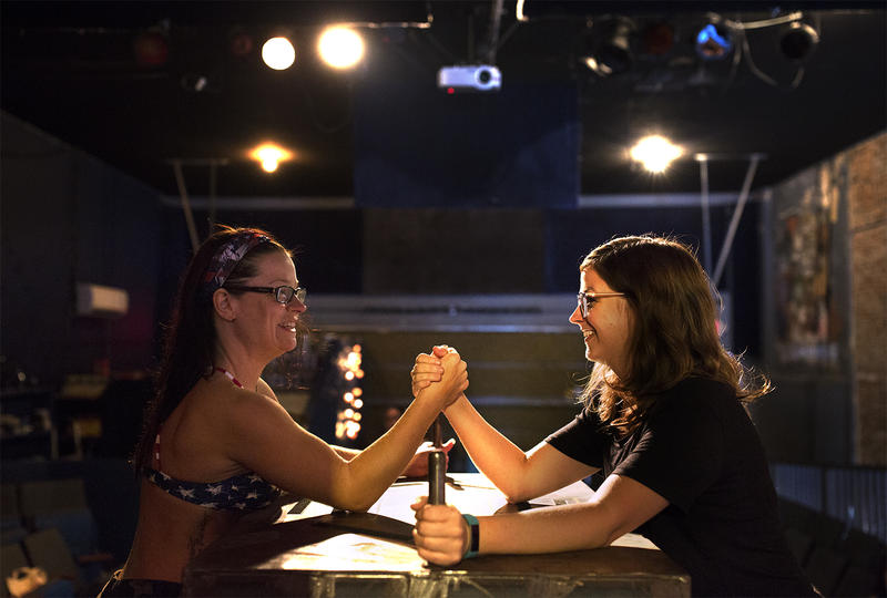Karen Downey as Betsy Boss, left, and Allison Harris as Emily Lickinson, right, speed through a quick arm wrestling match during a dress rehearsal at the Heavy Anchor bar.