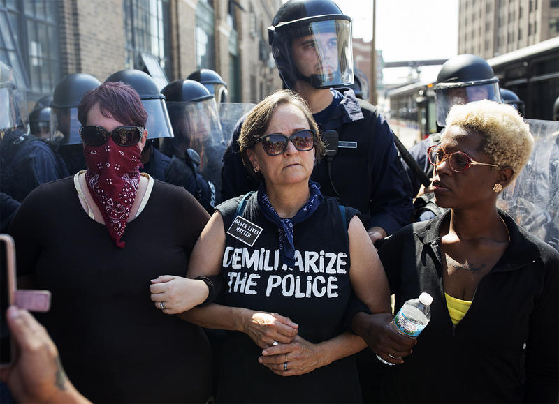Protesters linked arms on Sept. 15, 2017 in downtown St. Louis on Tucker St.