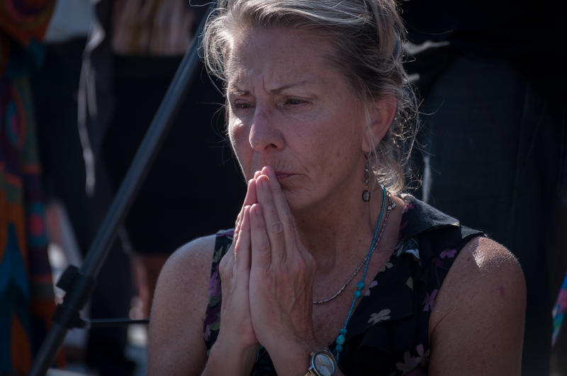 Laura Solsten, 60, of Creve Coeur, prays during a vigil Tuesday, Sept. 19, 2017, in downtown St. Louis.