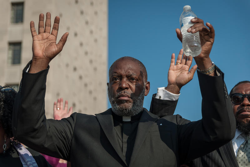 The Rev. Linden Bowie holds his hands up for six minutes on Tuesday, Sept. 19, 2017, to mark six years between the death of Anthony Lamar Smith and the acquittal of ex-St. Louis officer Jason Stockley during a vigil and march downtown.