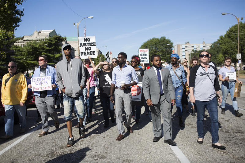 Protesters and small business owners march to City Hall to attend a Board of Alderman meeting a hold a press conference on Sept. 29, 2017.