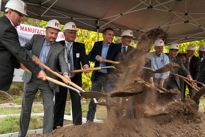 Ranken Technical College officials, elected leaders — including Missouri Gov. Eric Greitens, center — and donors hold a ceremonial groundbreaking for a new manufacturing incubator at the school's St. Louis campus on Friday.