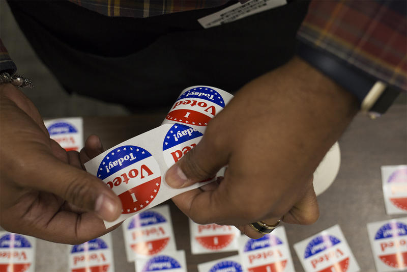 "A poll worker sets out ""I voted today"" stickers at the St. Louis County Board Of Elections on Oct. 25, 2018."
