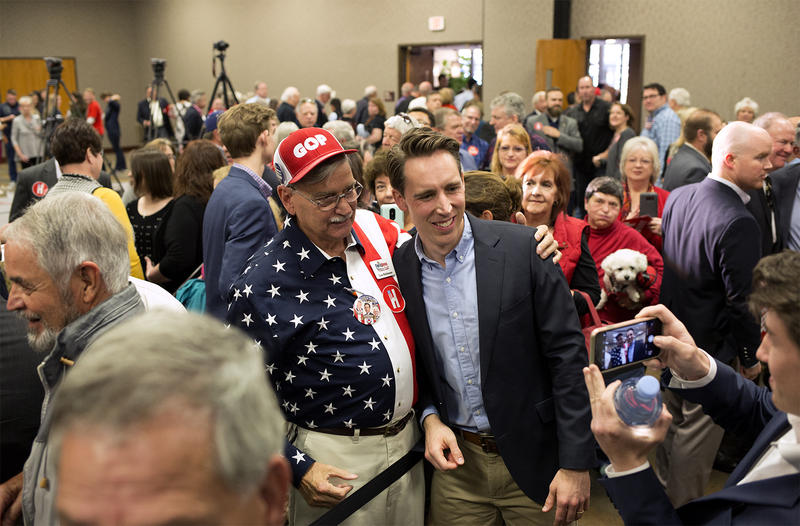 Missouri Attorney General and senatorial candidate Josh Hawley poses for photos with supporters at a campaign event in Chesterfield on Oct. 29, 2018.