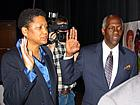 New board members Darnetta Clinkscale (left) and Ronald Jackson (right) take the oath of office Tuesday night.