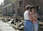SHOP OWNERS HUG IN TORNADO-DAMAGED PEIRCE CITY MISSOURI