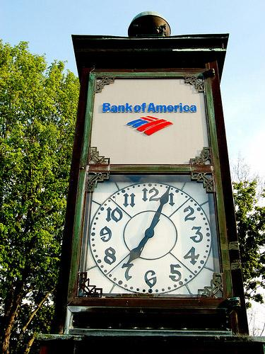 A clock in Lawrenceville, Va. sports the Bank of America logo. Bank of America, the nation's largest bank is to pay $137 million nationally as part of several settlements.
