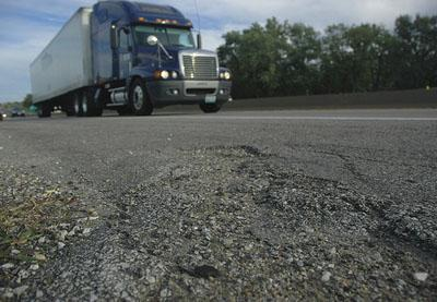 Cracks are seen in the shoulder of I-70 near the exit to the Providence Road in Columbia, Mo. The budget for the Missouri Department of Transportation is expected to drop by nearly half in 2011. (Via Flickr/ KOMUnews, Manu Bhandari)