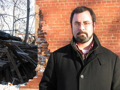 Andrew Weil is the Assistant Director of the Landmarks Association of St. Louis, where he works to preserve the area's 19th-century buildings. Lately, theives have been knocking them down to sell their bricks. (Mandi Rice, St. Louis Public Radio).