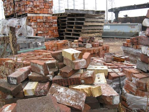 There is also a legal used brick industry in St. Louis, selling from businesses like this one, Century Used Brick. The legal market  is being undersold by the illegal products gathered by thieves. (Mandi Rice, St. Louis Publicr Radio).