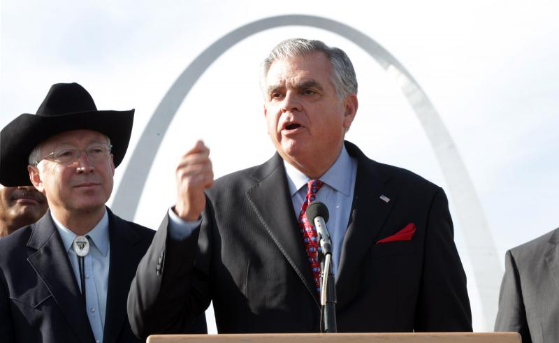 Secretary of the Interior Ken Salazar (L) looks on as Transportation Secretary Ray LaHood explains plans for improving and expanding the Jefferson National Expansion Memorial where the Gateway Arch sits, during a press conference across the Mississippi.