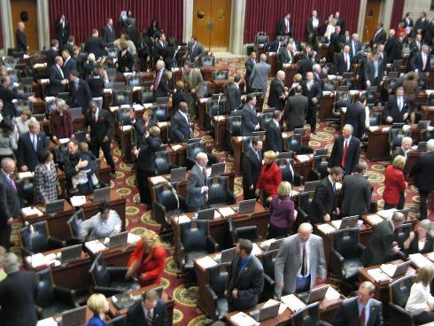Lawmakers in the Missouri House of Representatives greet each other as the 2011 session opens. (Marshall Griffin, St. Louis Public Radio)