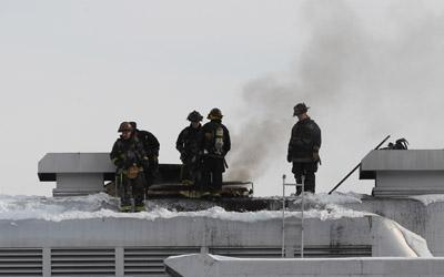 Firefighters battle a blaze at the Admiral riverboat on Jan. 21, 2012. The boat was being dismantled for scrap at the time.
