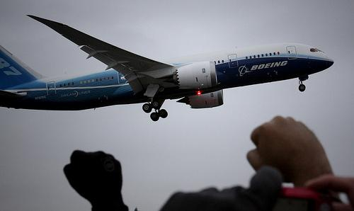 "The Boeing 787 Dreamliner on its ""First Flight"" in 2009. (via Flickr/Dave Sizer)"