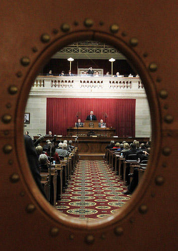 As seen through a door, Mo. Governor Jay Nixon delivers the State of the State speech to the legislature in the House of Represenatives chambers at the State Capitol in Jefferson City, Mo. on January 19, 2011. (UPI/Bill Greenblatt)
