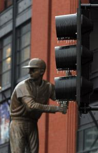 Traffic signals near the Stan Musial statue at Busch Stadium are encased in icicles as a freezing rain falls in St. Louis on Jan. 31, 2011. (UPI/Bill Greenblatt)
