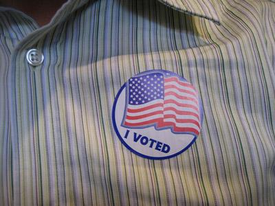 "The typical badge of a vote cast, the ""I Voted"" sticker."