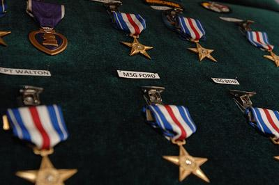 Silver Stars displayed for nineteen soldiers receiving the medal at Fort Bragg, N.C., Dec. 12, 2008. The Silver Star is the 3rd highest military decoration that can be awarded to U.S. Armed Forces members (via Flickr / The U.S. Army)