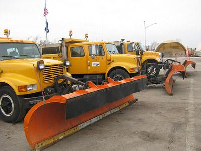 Snow plows stand at the ready for the Missouri Department of Transportation. A major winter storm is expected to hit the St. Louis area, beginning with freezing rain, later today. (Rachel Lippmann/St. Louis Public Radio)