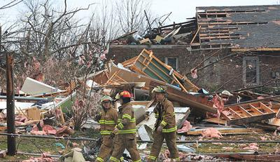 Firefighters survey damage after a possible tornado hit the surrounding area of Sunset Hills, Missouri on Dec. 31, 2010.  (UPI/Bill Greenblatt)
