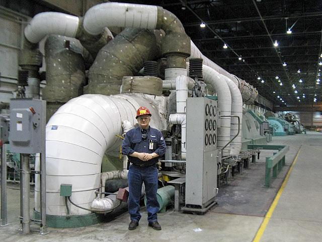 Shift supervisor Jim Dean stands in front of one of the Labadie power plant's four turbines. He has worked at the plant since 1976. (Véronique LaCapra, St. Louis Public Radio)