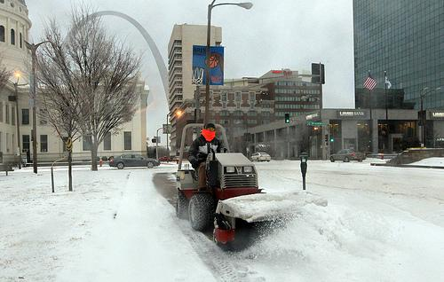 A city worker clears the sidewalks in downtown St. Louis on Tuesday. President Obama has declared all 114 Missouri counties and the city of St. Louis a federal disaster area following this week's winter storm.