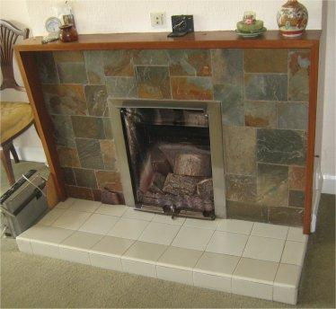 The fireplace of an eco-friendly home in Birmingham, United Kingdom. (via Flickr/bhamrecycled)
