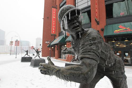 The statue of Baseball Hall of Fame member Lou Brock stands coated in ice outside of Busch Stadium in St. Louis on Feb. 1, 2011. (UPI/Bill Greenblatt)