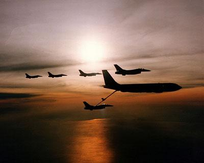 Five F-16 Fighting Falcon aircraft and a KC-135 Stratotanker in silhouette during an aerial refueling operation over MacDill Air Force Base, Fla. in 1998. The KC-135 is the aircraft in question in an impending announcement by the Pentagon.