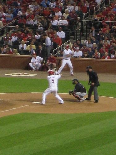 Albert Pujols bats during a 2009 game against the New York Mets. (Photo by Rachel Lippmann)