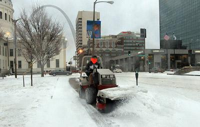 A city worker clears a sidewalk of ice and slush on Market Street in St. Louis on Feb. 1, 2011. Some city side streets which remain badly iced over will begin to be treated with a salt and sand mixture today. (UPI/Bill Greenblatt)