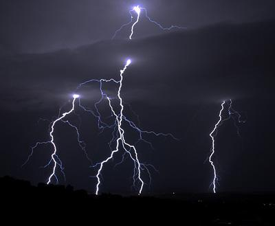 Lightning strikes in Placitas, N.M. in 2009. Storms, which may have included a few tornadoes, hit the St. Louis area late last night and early this morning.