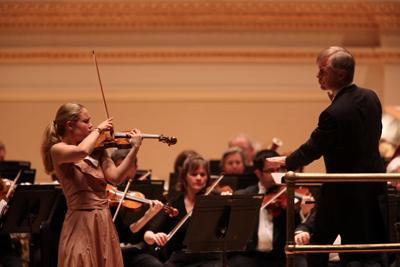 St. Louis Symphony's David Robertson (right) and Leila Josefowicz, Violin, during Saturday's performance.