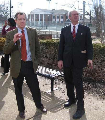 Clayton resident Arthur Gallagher (L) and his attorney Bevis Schock smoke cigars on the sidewalk near Shaw Park in Clayton. Gallagher is challenging the constitutionality of Clayton's ban on smoking in public parks.