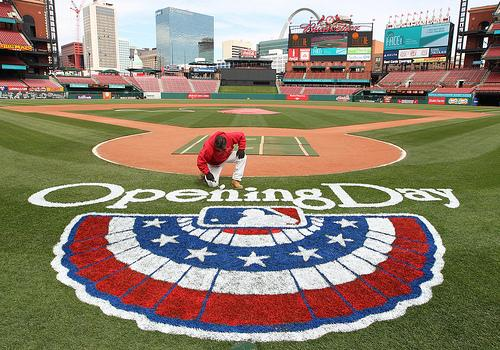 Billy Martin, the head painter at Busch Stadium, touches up the Opening Day logo. About 1500 meters in the city will be free on Opening Day from 10am until 30 minutes after the game ends.