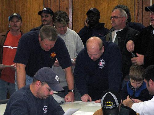 Firefighters from IAFF Local 73 on the day they learned about possible layoffs. A federal grant may allow the city to avoid those layoffs.