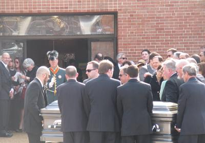 Pallbearers accompany the casket of Francis R. Slay outside St. Raymond's Maronite Cathedral in St. Louis on March 21, 2011.
