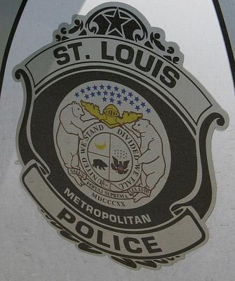 The logo of the St. Louis Metropolitan Police displayed on a patrol vehicle.