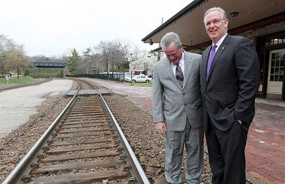 Missouri Governor Jay Nixon (R) and Missouri Department of Transportation Director Kevin Keith inspect tracks outside of the Kirkwood Amtrak Station in Kirkwood, Mo. on March 29, 2011.