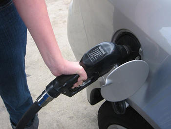 Drivers are in for a treat at the gas pump this month as prices drop due to a market surplus and weak demand.